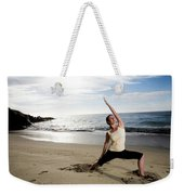 A Women At The Beach Performing Yoga Weekender Tote Bag