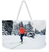 A Young Woman Cross-country Skiing Weekender Tote Bag
