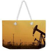 California Oil Field Under Amber Sky Weekender Tote Bag