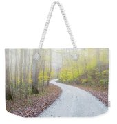 Road Passing Through A Forest Weekender Tote Bag
