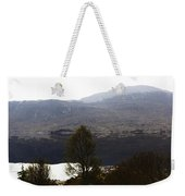 Trees On The Shore Of A Loch And Hills In The Scottish Highlands Weekender Tote Bag