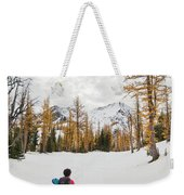 A Backpacker Hikes Through Snow Weekender Tote Bag