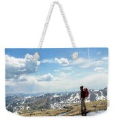 A Backpacker Stands Atop A Mountain Weekender Tote Bag