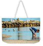 A Boy Searches The Water At Matheson Weekender Tote Bag