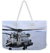 A Ch-53e Super Stallion Conducts Flight Weekender Tote Bag