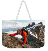 A Climber Scrambles Up A Rocky Mountain Weekender Tote Bag