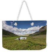 A Couple Hiking Through A Field Weekender Tote Bag