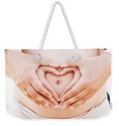 A Couple Making A Heart Shape On The Pregnant Belly With Their Hands Weekender Tote Bag