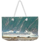 A Cruise Ship Passes By A Wolf Roaming Weekender Tote Bag