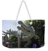A Dinosaur Exhibit With Visitors In The Universal Studios Singapore Weekender Tote Bag