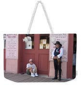 A Dog And A Re-enactor Rest In The Front Of The Bird Cage Theater Tombstone Arizona Weekender Tote Bag