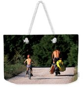 A Father And Son Ride Their Bikes To Go Weekender Tote Bag