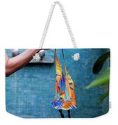 A Female Hand Holding A Bathing Suit Weekender Tote Bag
