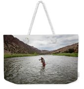 A Fly Fisherman Mends While Fishing Weekender Tote Bag
