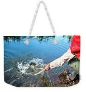 A Fly Fisherman Pulls A Fish Weekender Tote Bag