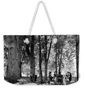 A Group Of People Eating Lunch Under Trees Weekender Tote Bag