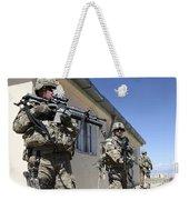 A Group Of U.s. Army Soldiers Provide Weekender Tote Bag