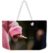 A Hand Holding A Cigarette Weekender Tote Bag