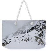 A Hiker Approaches A Snowy Peak Covered Weekender Tote Bag