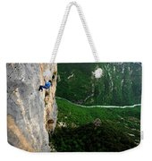 A Horizontal Image Of A Women In A Blue Weekender Tote Bag