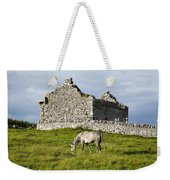 A Horse Grazing In A Field Weekender Tote Bag