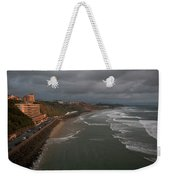 A Hotel Lit By A Pinkish Orange Sunset Weekender Tote Bag