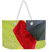 A Little Girl Walking In The Rain While Weekender Tote Bag