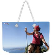 A Male Climber Looking At Paragliding Weekender Tote Bag