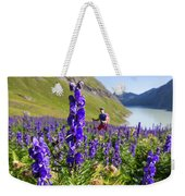 A Male Hiker In Sunny Flower Field Weekender Tote Bag