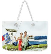 A Man And A Woman Embrace In Sailboat Weekender Tote Bag