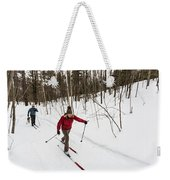 A Man And Woman Cross Country Skiing Weekender Tote Bag