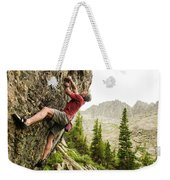 A Man Clinging To Rock Face In The Weekender Tote Bag