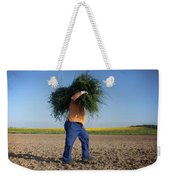 A Man Harvests Sedge To Be Used Weekender Tote Bag