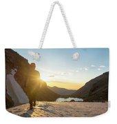 A Man Hiking On Snowfield At Sunrise Weekender Tote Bag