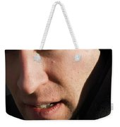 A Man Looks Up After Examining Weekender Tote Bag