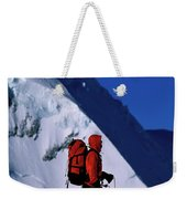 A Man Mountaineering In The Alps Weekender Tote Bag