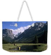 A Man Pulls His Canoe Up A River Valley Weekender Tote Bag