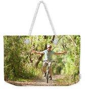 A Man Rides A Bicycle Weekender Tote Bag