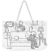A Man Sits On A Living Room Couch Weekender Tote Bag