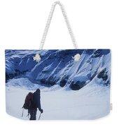 A Man Ski Touring Under Blue Skies Weekender Tote Bag