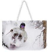 A Man Skiing Powder In The Trees Weekender Tote Bag