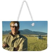 A Man Stands In A Field Next Weekender Tote Bag
