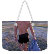 A Man Takes Off His Clothes And Walks Weekender Tote Bag