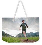 A Man Trail Runs Along The Spring Brook Weekender Tote Bag