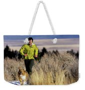 A Man Trail Runs On A Winter Day Weekender Tote Bag