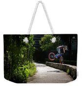 A Man With A Bike Standing On The Front Weekender Tote Bag
