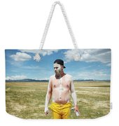 A Mans Face Covered In Clay Mud Weekender Tote Bag