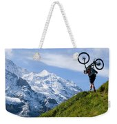 A Mountain Biker Is Carrying His Bike Weekender Tote Bag