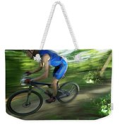 A Mountain Biker Races On A Trail Weekender Tote Bag