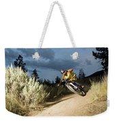 A Mountain Biker Rides A Trail Weekender Tote Bag
